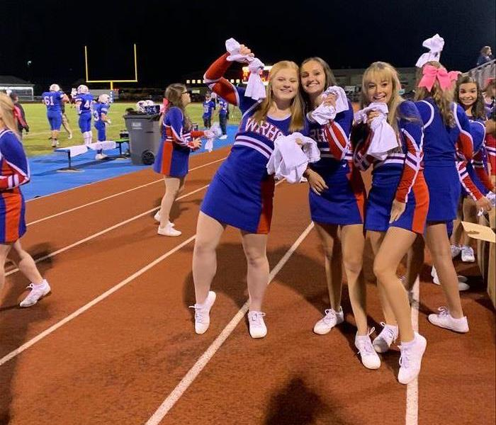 photo of Western Reserve cheerleaders holding SERVPRO shirts