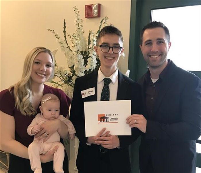 SERVPRO owners pose with scholarship winner