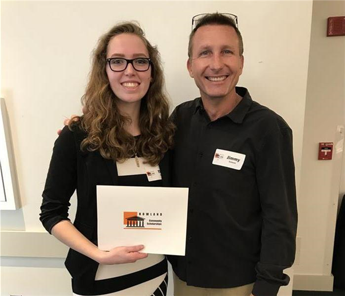 SERVPRO owner poses with scholarship winner